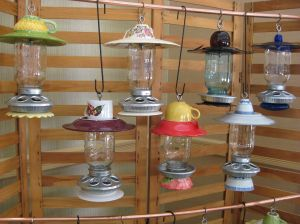 Bird feeders with Mason jars, cups and saucers