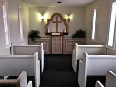 Altar and six pews